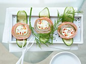 Cucumber and salmon roulade stuffed with cream cheese