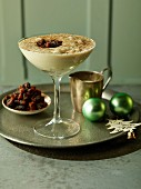 Brandy cream with cinnamon sugar and Christmas pudding crumbs (England)