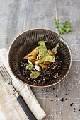 Beluga lentil salad with algae bacon and mozzarella