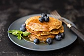 Gluten-free lupin pancakes with maple syrup and blueberries