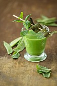 A vegan snow pea shot with algae bacon and mint (detox)