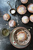 Small almond cakes dusted with icing sugar