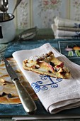 A piece of crostata with ricotta, apple and chocolate pieces