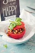 A tomato stuffed with chickpeas