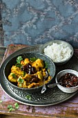 Chicken curry with a tamarind and date chutney and rice (India)