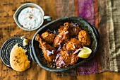 Tandoori chicken with raita (India)