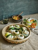 Courgette fish rolls with tomato and peach relish (low carb)