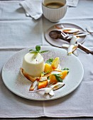 Coconut panna cotta with mint, peach and coconut chips (low carb)
