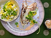 Tilapia fillets with heart of palm and a mango salad
