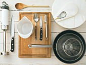 Kitchen utensils for making a green salad with smoked trout, potato croutons and horseradish sauce