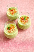 Cold courgette and mint soup garnished with diced red pepper and olive oil