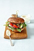 Portobello burger with grilled beef, red pepper and gherkins
