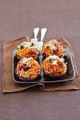 Baked portobello mushrooms stuffed with spaghetti with chorizo and black olives