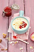 Milk soup with millet flakes and coconut and raspberry jam