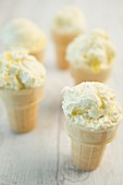 Lemon meringue ice cream in cones