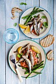 Fried sprats with tomato salad and asparagus