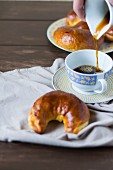 Crescent-shaped walnut pastries served with a cup of coffee