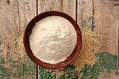 Quinoa flour in a wooden bowl