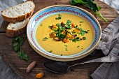Vegan sweet potato and turnip soup with fresh turmeric