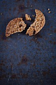 A broken oat, coconut and goji berry cookie