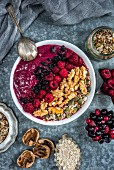 Mixed berry smoothie bowl with walnuts and seeds