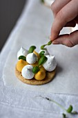 Lemon meringue tarts with basil
