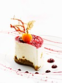 A small blueberry cheesecake with a physalis on the top