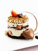 Tiramisu garnished with chocolate hearts and strawberry
