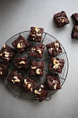 Brownies with cashew nuts on a cake rack