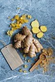Different types of ginger, fresh, grounded and candied, view from above