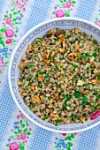 Pearl barley salad with walnuts for a picnic (see from above)