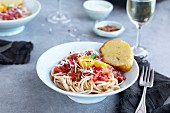 Roasted Tomato Basil Sauce over Brown Rice Spaghetti served with parmesan cheese, bread and wine