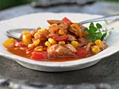 Chicken stew with corn and peppers