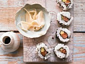 Inside-out rolls with salmon, avocado and sesame seeds