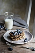 Breakfast with cereal bread and blueberries on wooden table