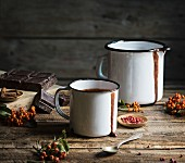 Mug with hot chocolate on wooden table