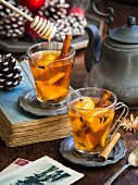 Hot winter spiced tea on a Christmas background