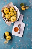 Quince in an enamel bowl with quince jelly