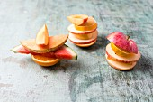 Fruit stacks with apple, watermelon, lemon, orange and banana