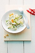 North German potato salad with mayonnaise, pickled cucumbers and egg