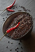 Black rice with dried chilli peppers