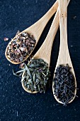 Various teas on bamboo spoons
