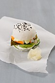 A sushi burger with cucumber, wasabi mayo, surimi, avocado, nori and pickled ginger