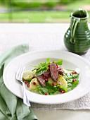 In Season - Warm lamb, potato & pomegranate salad