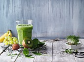 Green fitness smoothie with fruit and herbs