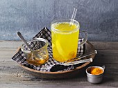 Hot lemon and ginger tea with turmeric