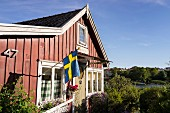 A Swedish house with flag in southern Sweden