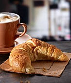 A croissant with a latte in a cafe