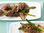 Beef kebabs on a bed of grilled vegetables with pomegranate vinaigrette