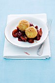Sweet dumplings with plums and breadcrumbs